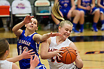 02/05/13--La Salle Prep Falcons Makenzie Cook (12) defends Gladstone Gladiators forward Alicia Feb (40) in the first half at Gladstone High School....Photo by Jaime Valdez.