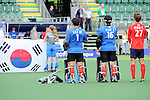 The Hague, Netherlands, June 10: Players of Korea line up prior to the field hockey group match (Men - Group B) between Germany and Korea on June 10, 2014 during the World Cup 2014 at Kyocera Stadium in The Hague, Netherlands. Final score 6-1 (3-0) (Photo by Dirk Markgraf / www.265-images.com) *** Local caption *** Myungho Lee #1 of Korea, Jaehyeon Kim #16 of Korea, Byungjin Jeon #27 of Korea