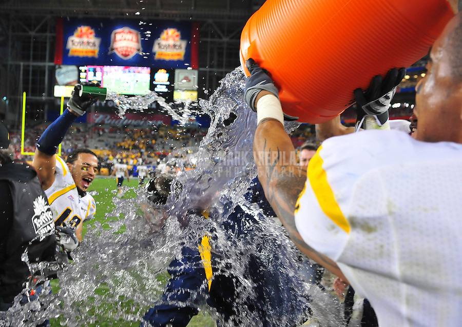 Jan 2, 2008; Glendale, AZ, USA; West Virginia Mountaineers interm head coach Bill Stewart is doused with gatorade in the closing seconds of the game against the Oklahoma Sooners during the Fiesta Bowl at University of Phoenix Stadium. West Virginia defeated Oklahoma 48-28. Mandatory Credit: Mark J. Rebilas-US PRESSWIRE.