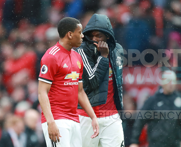 Paul Pogba of Manchester United covers his face as he walks off talking to Anthony Martial of Manchester United during the premier league match at the Old Trafford Stadium, Manchester. Picture date 15th April 2018. Picture credit should read: Simon Bellis/Sportimage