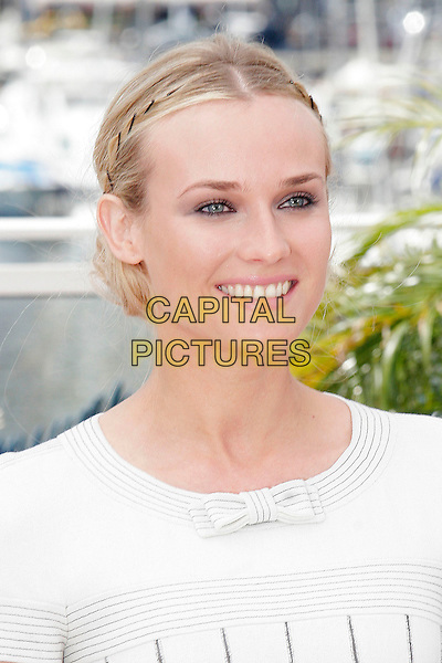 DIANE KRUGER.The German actress, who is the Master Of Ceremonies, attends a photocall during the 60th International Cannes Film Festival, Cannes, France,.May 16, 2007..portrait headshot bow cream hair twists style clips smiling.CAP/DAR.©Darwin/Capital Pictures