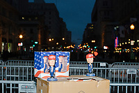 Donald Trump bobbleheads featuring the red Make America Great Again hat were sold by a street vendor near barricades in the street after the inauguration of President Donald Trump on Jan. 20, 2017, in Washington, D.C.