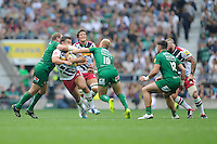 Nick Easter of Harlequins is tacked around the neck by David Paice of London Irish as Shane Geraghty of London Irish supports during the Premiership Rugby Round 1 match between London Irish and Harlequins at Twickenham Stadium on Saturday 6th September 2014 (Photo by Rob Munro)