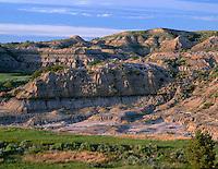 NDTR_101 - USA, North Dakota, Theodore Roosevelt National Park, Eroded sedimentary hillside and grassy prairie near Boicourt Overlook in the South Unit.