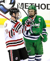 Nebraska Omaha's Ryan Walters and Mercyhurst's Derek Elliott. (Photo by Michelle Bishop) .