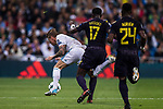 Toni Kroos of Real Madrid (L) fights for the ball with Moussa Sissoko of Tottenham Hotspur FC (C) and Serge Aurier of Tottenham Hotspur FC (R) during the UEFA Champions League 2017-18 match between Real Madrid and Tottenham Hotspur FC at Estadio Santiago Bernabeu on 17 October 2017 in Madrid, Spain. Photo by Diego Gonzalez / Power Sport Images