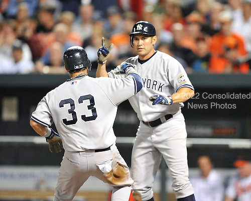 Baltimore, MD - September 2, 2009 -- New York Yankees first baseman Nick Swisher (33) and left fielder Johnny Damon (18) celebrate after scoring in the seventh inning against the Baltimore Orioles at Oriole Park at Camden Yards in Baltimore, MD on Wednesday, September 2, 2009.  The Yankees won the game 10 - 2..Credit: Ron Sachs / CNP.(RESTRICTION: NO New York or New Jersey Newspapers or newspapers within a 75 mile radius of New York City)