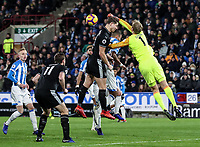 Burnley's James Tarkowski competing with Huddersfield Town's goalkeeper Jonas Lossl<br /> <br /> Photographer Andrew Kearns/CameraSport<br /> <br /> The Premier League - Huddersfield Town v Burnley - Wednesday 2nd January 2019 - John Smith's Stadium - Huddersfield<br /> <br /> World Copyright © 2019 CameraSport. All rights reserved. 43 Linden Ave. Countesthorpe. Leicester. England. LE8 5PG - Tel: +44 (0) 116 277 4147 - admin@camerasport.com - www.camerasport.com
