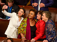 United States Representative Alexandria Ocasio-Cortez (Democrat of New York), left, takes a selfie with, from left to right, US Representative Barbara Lee (Democrat of California), US Representative Annie Kuster (Democrat of New Hampshire), and US Representative Jan Schakowsky (Democrat of Illinois) as the 116th Congress convenes for its opening session in the US House Chamber of the US Capitol in Washington, DC on Thursday, January 3, 2019. Photo Credit: Ron Sachs/CNP/AdMedia