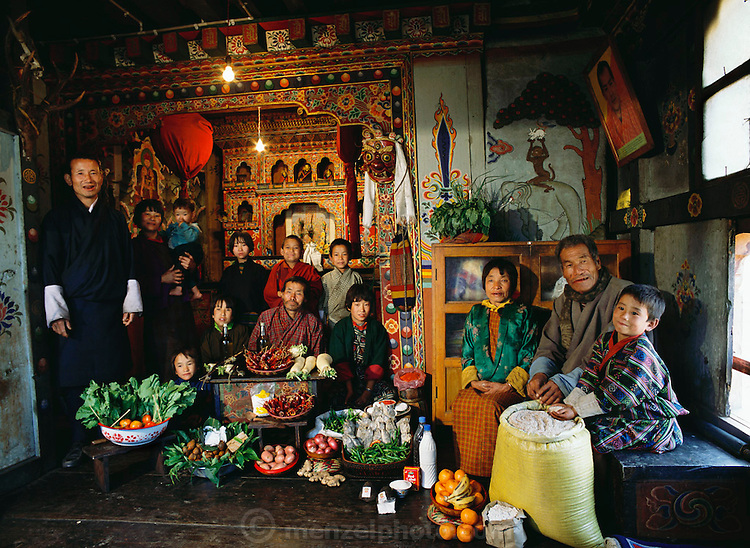 Photograph of Nalim and Namgay's family with one week's worth of food constructed for the book Hungry Planet: What the World Eats. From coverage of revisit to Material World Project family in Bhutan, 2001.