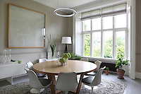 20th century dining furniture, including Eero Saarinen Tulip chairs, combined with original architectural features, such as the cornice, demonstrates the simpathetic modernisation of the old house