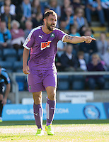 Peter Hartley of Plymouth Argyle gives instructions during the Sky Bet League 2 match between Wycombe Wanderers and Plymouth Argyle at Adams Park, High Wycombe, England on 12 September 2015. Photo by Andy Rowland.