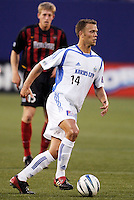 The MetroStars' John Wolyniec watches the  Wizard's Jack Jewsbury. The Kansas City Wizards were defeated by  the NY/NJ MetroStars to a 1 to 0 at Giant's Stadium, East Rutherford, NJ, on May 30, 2004.