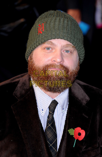 ZACH GALIFIANAKI.'Due Date' UK film premiere at the Empire cinema, Leicester Square, London, England, UK,.3rd November 2010..portrait headshot green knitted beanie hat poppy black tie plaid .CAP/WIZ.©Wiz/Capital Pictures