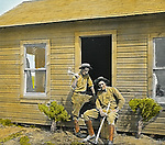 Jerome ID:  Landscaping and fixing the cabin on the 160 acre Jerome estate.  As part of the land grant, there was an old farmhouse that was in dire need of repair - 1909.  Brady Stewart and three friends went to Idaho on a lark from 1909 thru early 1912.  As part of the Mondell Homestead Act, they received a grant of 160 acres north of the Snake River.  Brady Stewart photographed the adventures of farming along with the spectacular landscapes. To give family and friends a better feel for the adventure, he hand-color black and white negatives into full-color 3x4 lantern slides.  The Process:  He contacted a negative with another negative to create a positive slide.  He then selected a fine brush and colors and meticulously created full color slides.