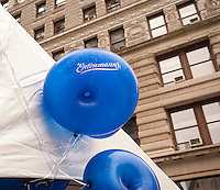 "Donut shaped balloons in Flatiron Plaza in New York for the celebration of National Donut Day on Friday, June 5, 2015. Supported by Entenmann's, the bakers gave out 40,000 chocolate donuts and donated $30,000 to the Salvation Army. National Donut Day, the first Friday in June, was created in 1938 by the Salvation Army to honor the ""donut lassies"" who administered treats and solace to soldiers during WW1. Entenmann's is a division of Bimbo Bakeries USA. (©  Richard B. Levine)"