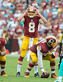 Washington Redskins quarterback Kirk Cousins (8) calls signals in the second quarter against the Miami Dolphins at FedEx Field in Landover, Maryland on September 13, 2015.  Also pictured center Kory Lichtensteiger (78).<br /> Credit: Ron Sachs / CNP
