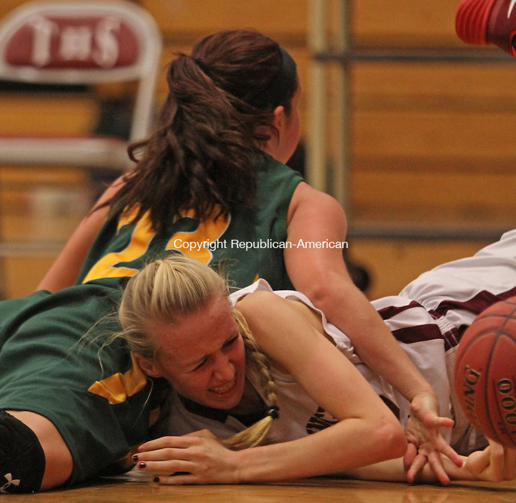 Torrington, CT-122313MK03 Torrington's Paige Middleton (12) battles Holy Cross' Chesea Houlihan (23) for the ball during NVL basketball action at Torrington High School Monday night.  Holy Cross defeated Torrington 52-43.  Michael Kabelka Republican-American