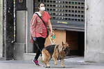 A woman walks her dog through the streets of Madrid during the health crisis due to the Covid-19 virus pandemic - Coronaviruss. April 27,2020. (ALTERPHOTOS/Alejandro de Dios)