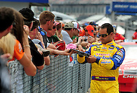 Apr 26, 2008; Talladega, AL, USA; NASCAR Sprint Cup Series driver Juan Pablo Montoya signs autographs during qualifying for the Aarons 499 at Talladega Superspeedway. Mandatory Credit: Mark J. Rebilas-US PRESSWIRE