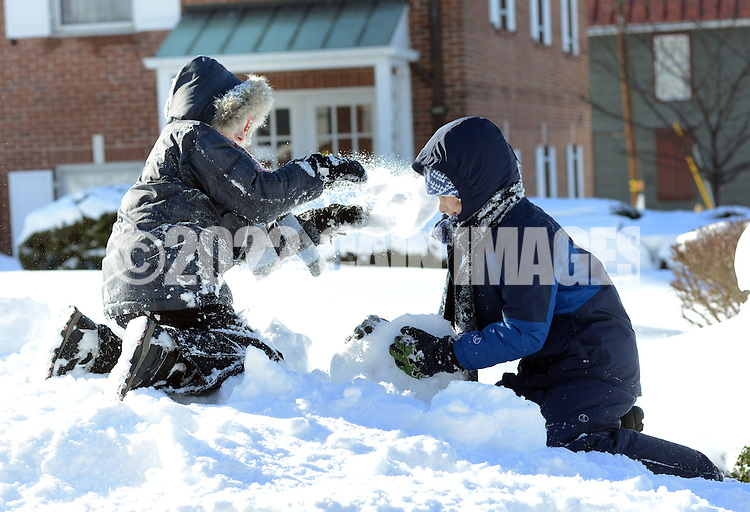 Jonathan Grunde-McLaughlin (left), 8 of Newtown, Pennsylvania throws snow at his brother Andrew Grunde-McLaughlin, 10, also of Newtown, Pennsylvania a day after Winter Storm Jonas Sunday January 24, 2016 in Newtown, Pennsylvania. (Photo by William Thomas Cain)