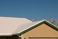 Snow on the rooftop of a home in Monroe, Washington following a Janaury winter snowstorm in the Pacific Northwest.