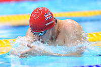 PICTURE BY ALEX BROADWAY /SWPIX.COM - 2012 London Paralympic Games - Day Three - Swimming - Aquatic Centre, Olympic Park, London, England - 01/09/12 - Thomas Young of Great Britain competes in the Men's 100m Breaststroke SB7 Heats.