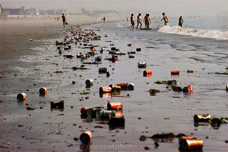 Boston, Massachusetts. Cans litter Revere Beach, after high school graduation night. Pollution, recycling.