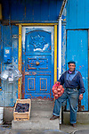 Chilean man holding sack of potatoes, Patagonia, South America