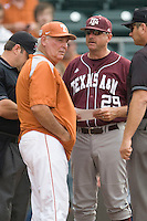 Texas A&M Aggies Coach Rob Childress meets with Augie Garrido, the coach of Texas Longhorns in NCAA Big XII Conference baseball on May 21, 2011 at Disch Falk Field in Austin, Texas. (Photo by Andrew Woolley / Four Seam Images)