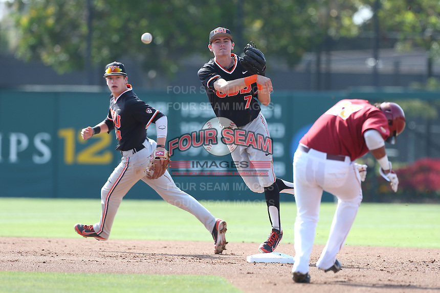 Trever Morrison #7 of the Oregon State Beavers throws to first base after forcing out Timmy Robinson #28 of the Southern California Trojans at second base during a game at Dedeaux Field on May 23, 2014 in Los Angeles, California. Southern California defeated Oregon State, 4-2. (Larry Goren/Four Seam Images)