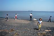 Ile D'Orleans, Quebec City Area, Canada, June 8, 1984. Kids playing on the Saint Laurent River banks.