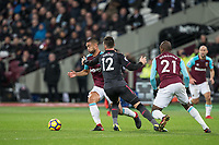 Olivier Giroud of Arsenal goes down under challenge from Winston Reid of West Ham United in the area during the Premier League match between West Ham United and Arsenal at the Olympic Park, London, England on 13 December 2017. Photo by Andy Rowland.