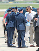 United States President Barack Obama shakes hands with a group of U.S. Air Force officers as he prepares to board Marine 1 to depart Joint Base Andrews, near Camp Springs, Maryland for a weekend at Camp David following a round of golf on Friday, July 5, 2013.<br /> Credit: Ron Sachs / Pool via CNP