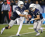 Nevada quarterback Cody Fajardo hands off to Kendall Brock in an NCAA college football game against San Jose State, in Reno, Nev., on Saturday, Nov. 16, 2013. (AP Photo/Cathleen Allison)