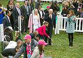 United States President Donald J. Trump and first lady Melania Trump blow whistles to start the Easter Egg race as they host the annual White House Easter Egg Roll on the South Lawn of the White House in Monday, April 2, 2018.  Donald Trump, Jr. and Tiffany Trump look on from the left.<br /> Credit: Ron Sachs / CNP