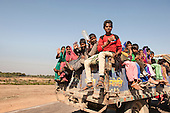 Rajasthan, India. Sawai Madhopur, near Ranthambore. Kids on the back of a truck.