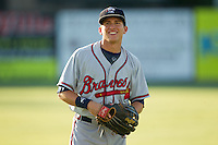 Kyle Wren (16) of the Rome Braves warms up in the outfield prior to the game against the Kannapolis Intimidators at CMC-Northeast Stadium on August 24, 2013 in Kannapolis, North Carolina.  The Intimidators defeated the Braves 6-1.  (Brian Westerholt/Four Seam Images)