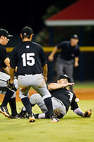 Michael Schwartz #38 makes a sliding attempt to catch a pop fly behind the pitchers mound as Bradley Salgado #33 and Jeffer Patino #15 look on at Burlington Athletic Stadium August 13, 2010, in Burlington, North Carolina.  Photo by Brian Westerholt / Four Seam Images