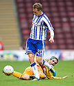 KILMARNOCK'S DEAN SHIELS IS CHALLENGED BY MOTHERWELL'S KEITH LASLEY