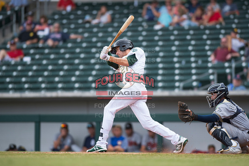Mesa Solar Sox designated hitter Eli White (21), of the Oakland Athletics organization, follows through on his swing in front of catcher Mario Feliciano (6) during an Arizona Fall League game against the Peoria Javelinas at Sloan Park on October 11, 2018 in Mesa, Arizona. Mesa defeated Peoria 10-9. (Zachary Lucy/Four Seam Images)