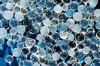 SILICA GEL- DESICCANT<br /> (Variations Available)<br /> Silica Gel<br /> Close-up Silica gel packets are found in anything that would be affected by excess moisture or condensation. Silica gel is nearly harmless and  may be found in food products. Silica, or Silicon Dioxide (SiO2), is the same material found in quartz.