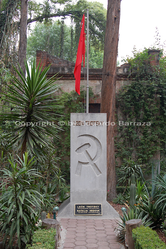 "Coyoacan, Mexico City - The burial site of Leon Trotsky in the gardens surrounding his house in Mexico City. The Leon Trotsky House Museum is a venue honoring Leon Trotsky's life.  The venue displays memorabilia such as photographs, newspapers and Trotsky personal effects.  The site also houses an organization that works to promote political asylum.  The museum is a favorite destination of millions of tourists every year, and it is located in the Coyoacan borough of Mexico City.  The museum was built next to the house in which Trotsky lived with his second wife Natalia Sedova from 1939 to 1940, and where the Russian dissident was also murdered and buried.  The house has been preserved as it was at that time where Trotsky lived there, in particular the study in which Joseph Stalin' supporter Ramon Mercader killed Trotsky with an ice axe to the back of the head.  Around the house is a garden and high walls with watchtowers.  The complex was turned into the current museum and asylum institution in 1990, on the 50th anniversary of the assassination.  Coyoacan's name comes from Nahuatl it likely meaning ""place of coyotes"".  Hernán Cortes and the Spanish conquistadors used this area as a headquarters during the Spanish conquest of the Aztec Empire. They also made it the first capital of New Spain between 1521 and 1523.  In recent times, has been a counterculture hotbed and where Frida Kahlo and Diego Rivera lived, a few blocks away from Leon Trotsky.  Due the historic and cultural relevance, their homes are now the Frida Kahlo Museum and the Leon Trotsky Museum, which are visited by thousands of tourists every year.  Modern-day Coyoacan is a quiet residential area with cobblestone streets, restaurants, parks, squares, and a favorite hangout for bohemia enthusiasts. Photo by Eduardo Barraza © Copyright"