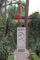 """Coyoacan, Mexico City - The burial site of Leon Trotsky in the gardens surrounding his house in Mexico City. The Leon Trotsky House Museum is a venue honoring Leon Trotsky's life.  The venue displays memorabilia such as photographs, newspapers and Trotsky personal effects.  The site also houses an organization that works to promote political asylum.  The museum is a favorite destination of millions of tourists every year, and it is located in the Coyoacan borough of Mexico City.  The museum was built next to the house in which Trotsky lived with his second wife Natalia Sedova from 1939 to 1940, and where the Russian dissident was also murdered and buried.  The house has been preserved as it was at that time where Trotsky lived there, in particular the study in which Joseph Stalin' supporter Ramon Mercader killed Trotsky with an ice axe to the back of the head.  Around the house is a garden and high walls with watchtowers.  The complex was turned into the current museum and asylum institution in 1990, on the 50th anniversary of the assassination.  Coyoacan's name comes from Nahuatl it likely meaning """"place of coyotes"""".  Hernán Cortes and the Spanish conquistadors used this area as a headquarters during the Spanish conquest of the Aztec Empire. They also made it the first capital of New Spain between 1521 and 1523.  In recent times, has been a counterculture hotbed and where Frida Kahlo and Diego Rivera lived, a few blocks away from Leon Trotsky.  Due the historic and cultural relevance, their homes are now the Frida Kahlo Museum and the Leon Trotsky Museum, which are visited by thousands of tourists every year.  Modern-day Coyoacan is a quiet residential area with cobblestone streets, restaurants, parks, squares, and a favorite hangout for bohemia enthusiasts. Photo by Eduardo Barraza © Copyright"""