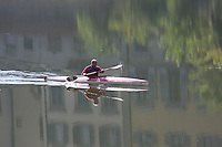 The reflection of a canoeist in the water of the Florentine  river Arno .