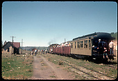 RGS #74 is leading RMRRC excursion southbound at Dallas Divide.  Consist is cabooses #0400 and #0401, three gondolas and business car B-20 &quot;Edna&quot;.<br /> RGS  Peak, CO  9/1/1951