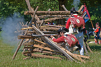 Continental and British Army reenactors exchanging musket fire, Revolutionary War, Monmouth Battlefield State Park, New Jersey