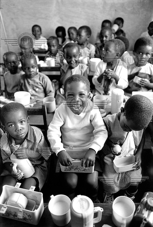 © Crispin Hughes / Panos Pictures..Kampala, UGANDA..Namirembe Nursery School is run by the church. Of the 112 children between the ages of 3 and 6, about a quarter are AIDS orphans.