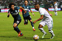 CALI - COLOMBIA -23-05-2014: Frank Fabra (Der.) jugador de Deportivo Cali disputa el balón con Jairo Palomino (Izq) jugador de Atletico Nacional durante partido de vuelta entre Deportivo Cali y Atletico Nacional por los cuartos de final de la Liga Aguila I 2015 en el estadio Deportivo Cali (Palmaseca) de la ciudad de Cali. / Frank Fabra (R) player of Deportivo Cali fights for the ball with Jairo Palomino (L) players of Atletico Nacional during a match for the second leg between Deportivo Cali and Atletico Nacional for the quarter of finals of the Liga Aguila I 2015 at the Deportivo Cali (Palmaseca) stadium in Cali city. Photo: VizzorImage /  NR / Cont.