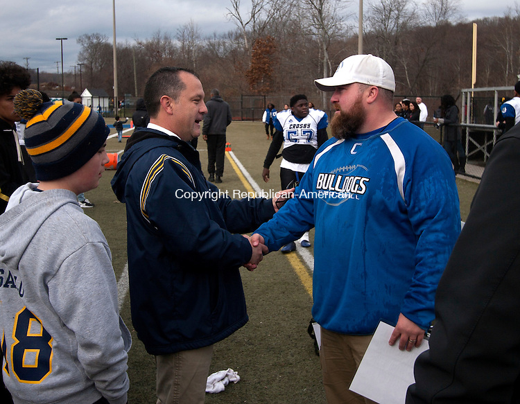 WATERURY, CT - 26 NOVEMBER 2015 -112615JW13.jpg -- Kennedy Coach Chris Sarlo congratulates Crosby Coach Dave Jurewicz on Crosbys win during the Thanksgiving Day 2015 Brass Division and City Championship game at Ray Snyder Sr. Field Thursday morning. Crosby won 18-15.  Jonathan Wilcox Republican-American